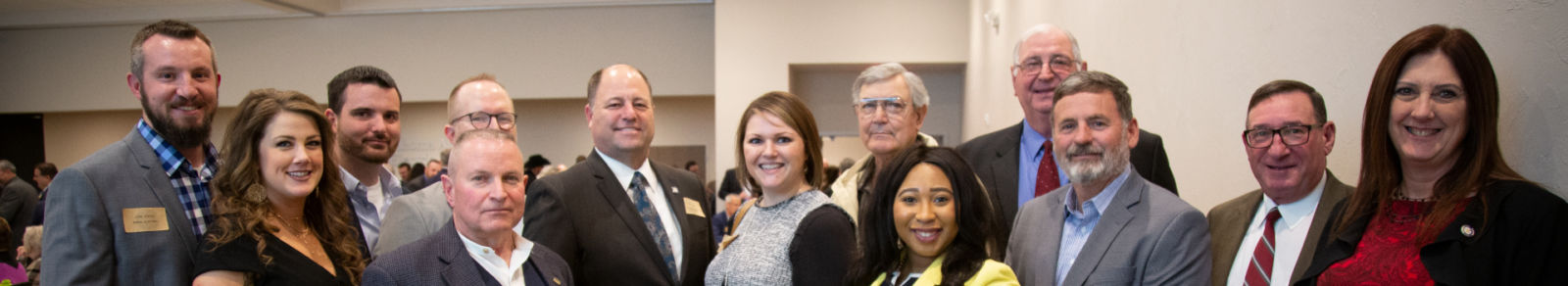 Up close photo of the faces of cooperative members and legislative staff/board members