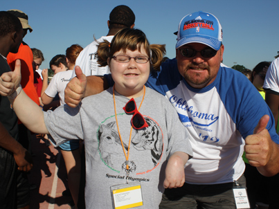 Child and parent/mentor participating in the Special Olympics